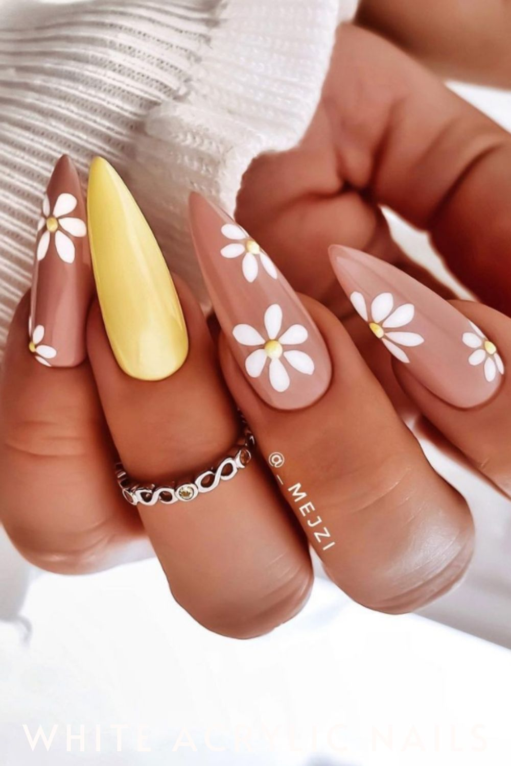 Pink and yellow almond nails with white flower