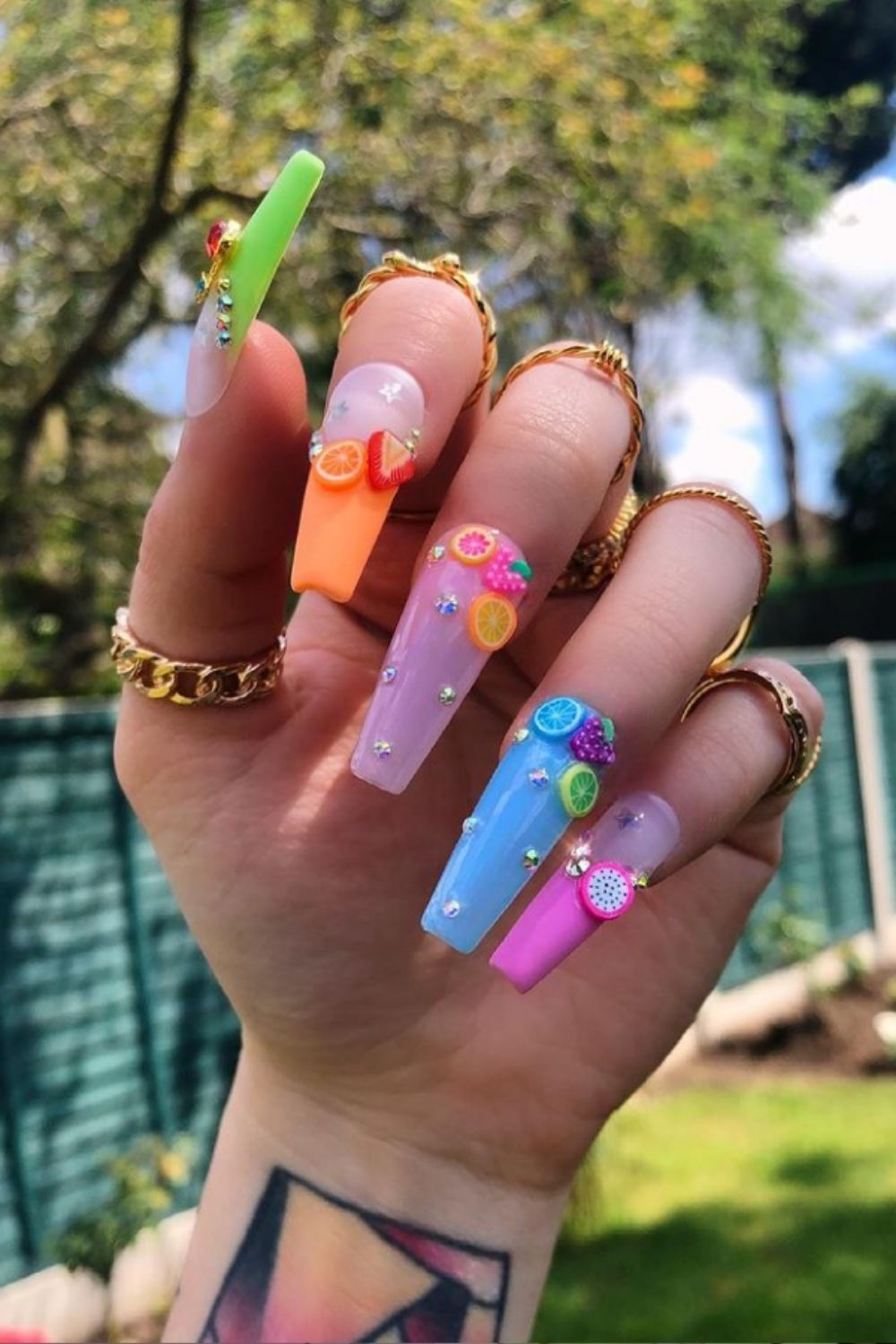 Coffin nail nail art design with fruit