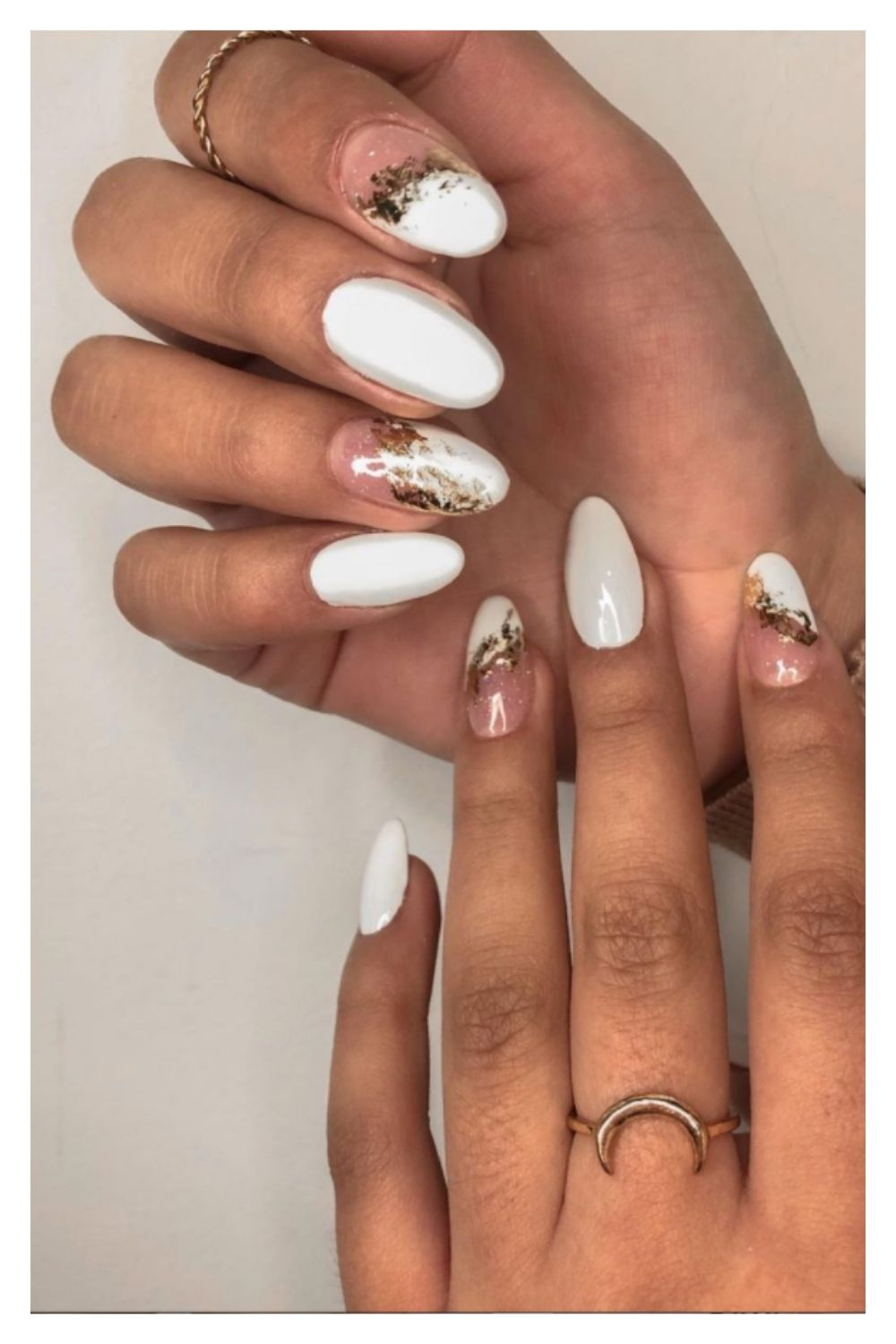 Gold and white almond nails