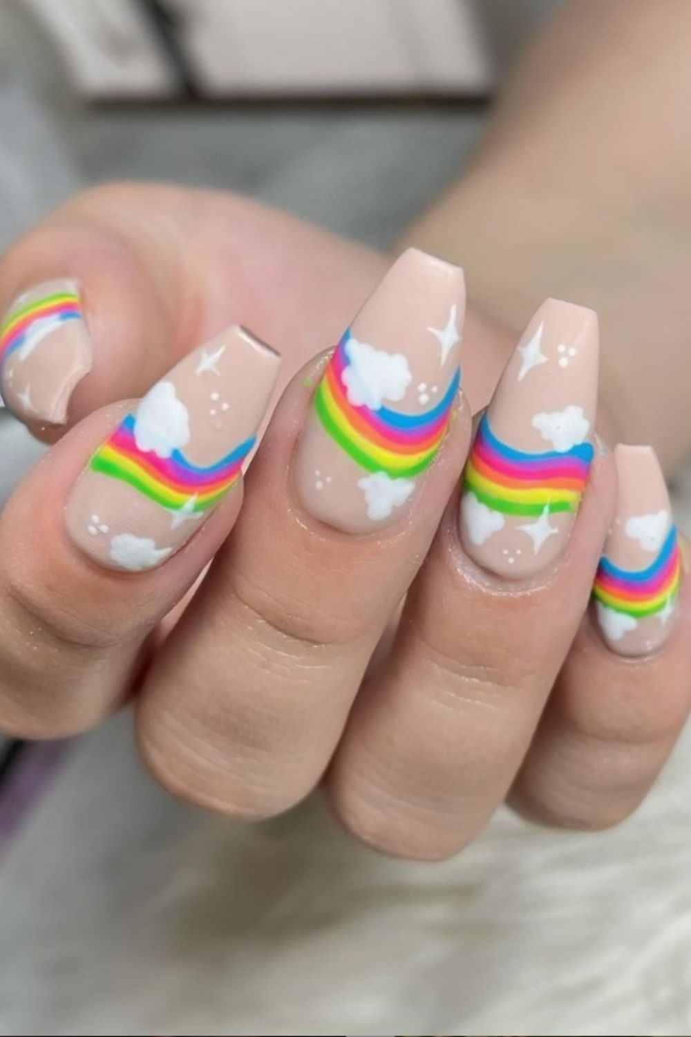 Coffin nail design with rainbow and white clouds