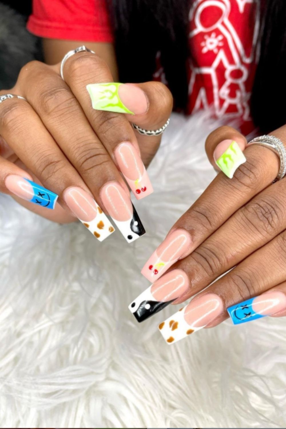 Cherry and smiley face long nail design