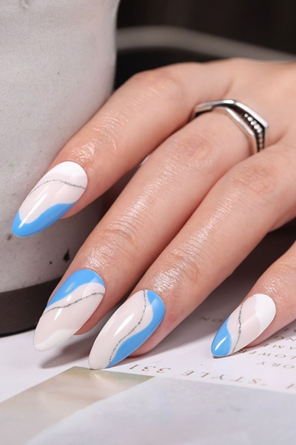 Light blue and silver striped almond acrylic nails