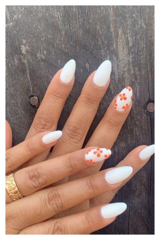 White and orange flower almond nails