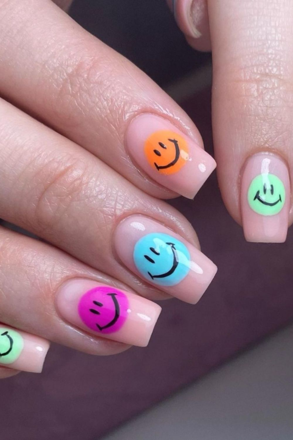 Smiley face long nail design in different colors