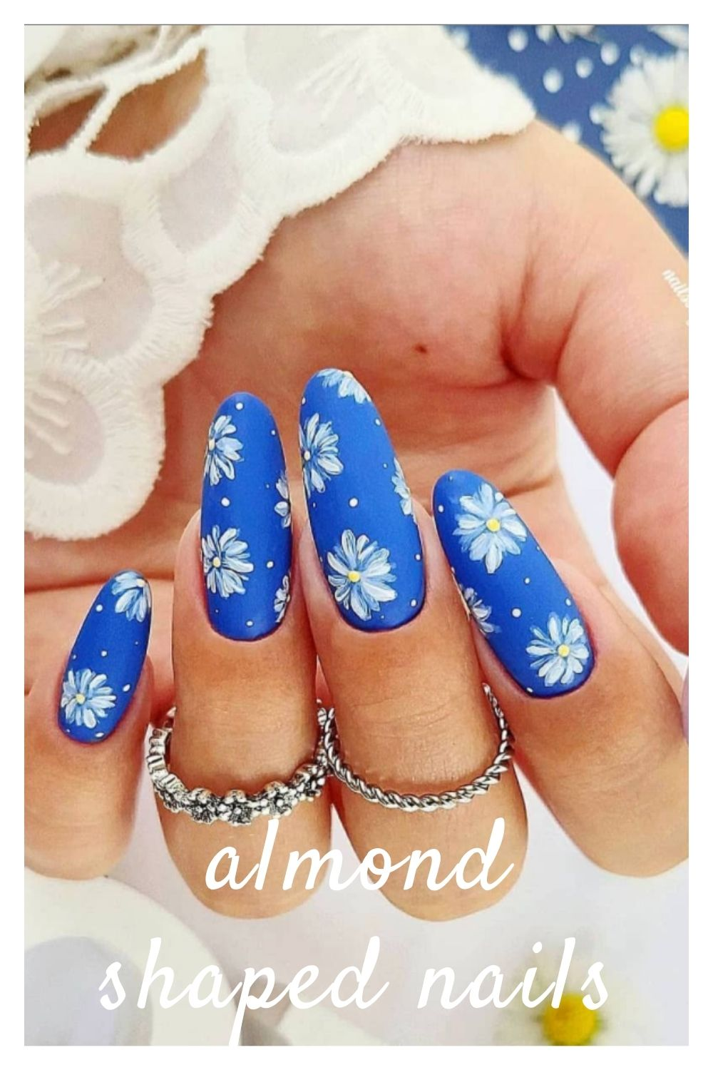 Blue almond nails with flowers
