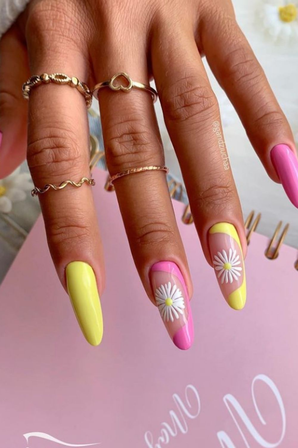 Pink and yellow almond nails with flowers
