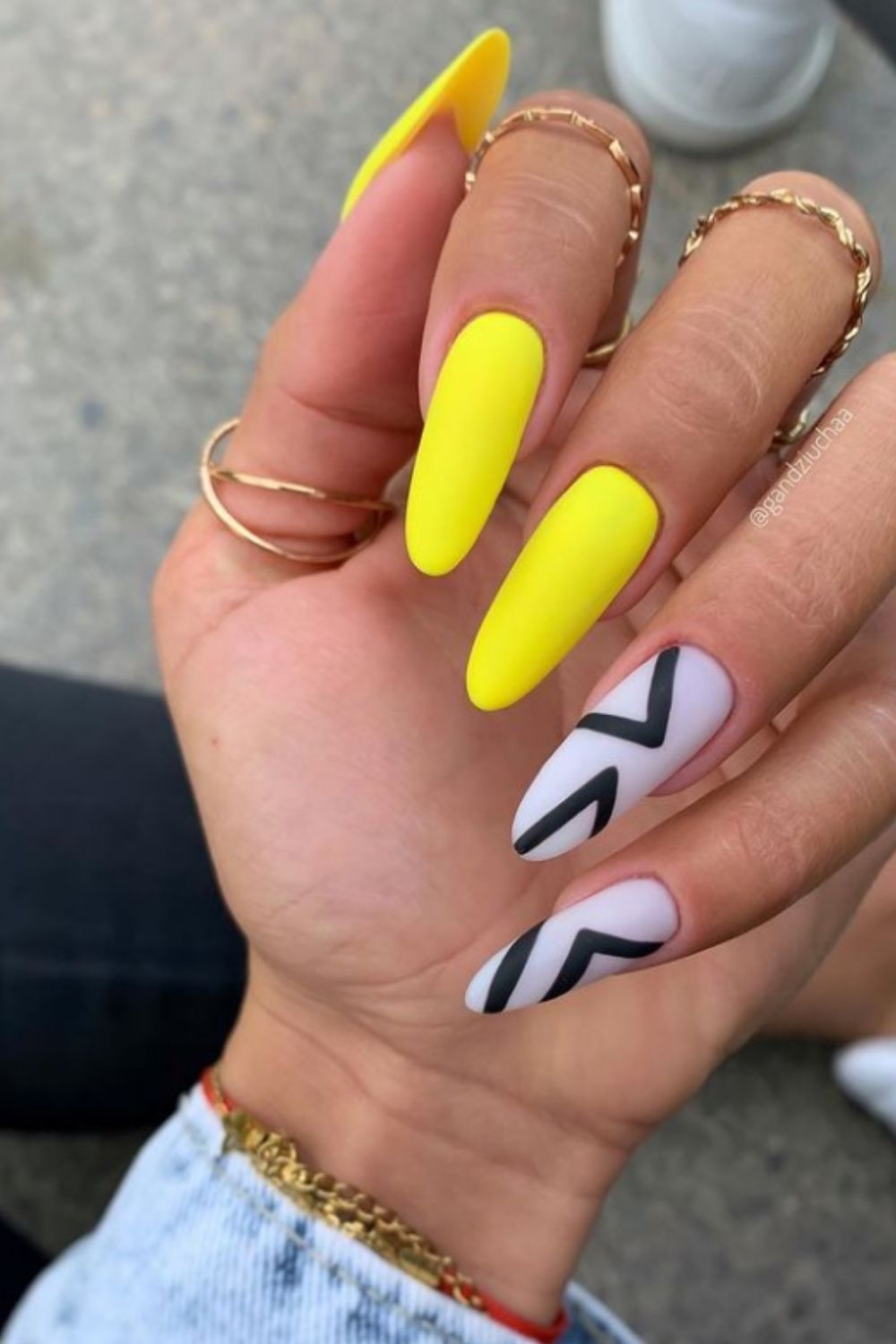 Yellow, white and black almond nails