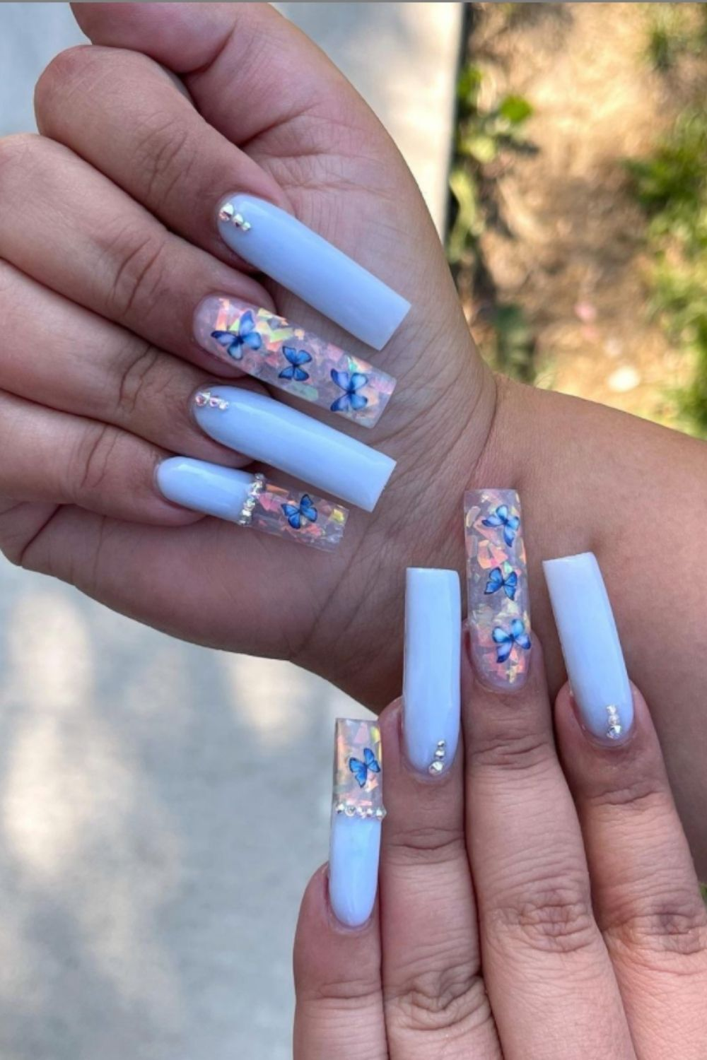 Light blue coffin nails art designs with butterfly