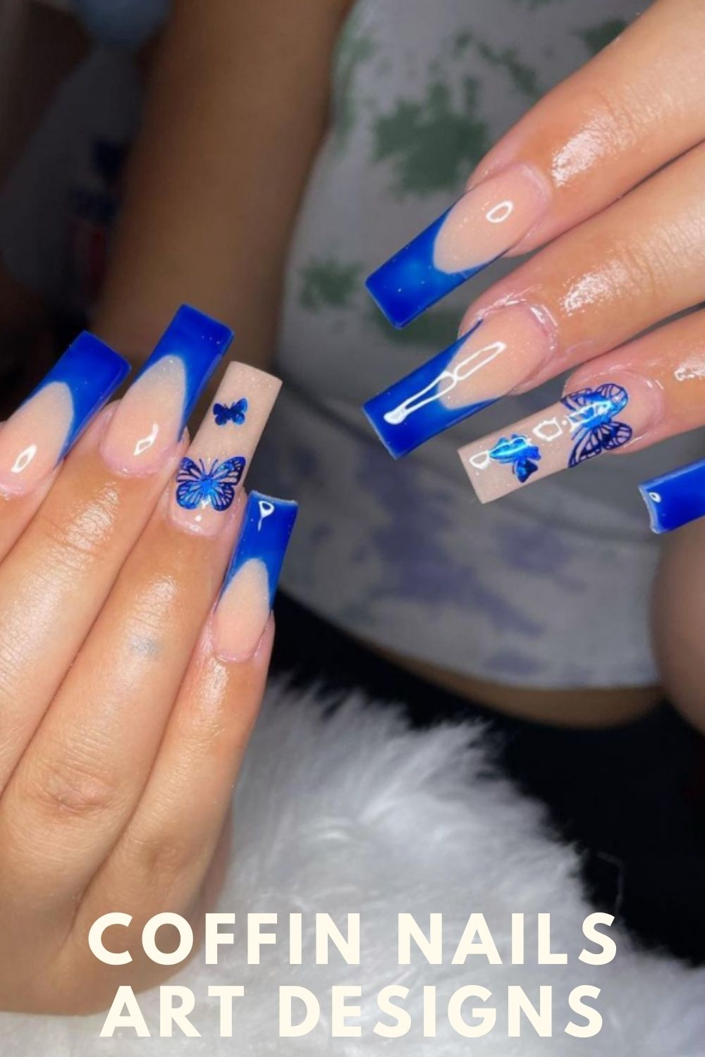 Blue coffin shape nail design with butterfly