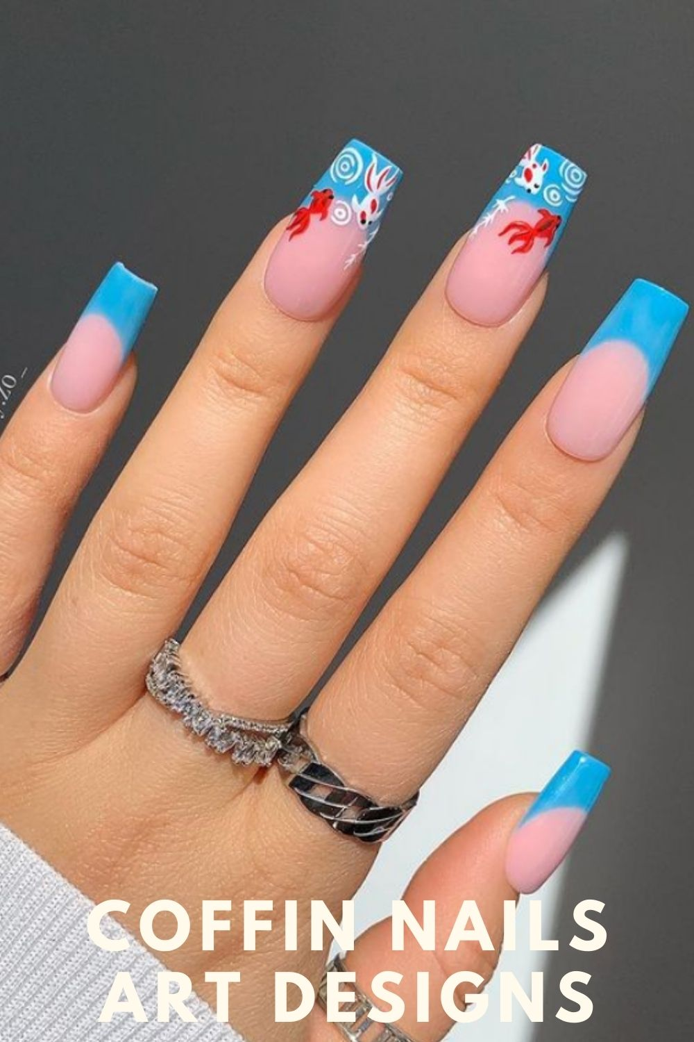 Light blue coffin nails designs with goldfish