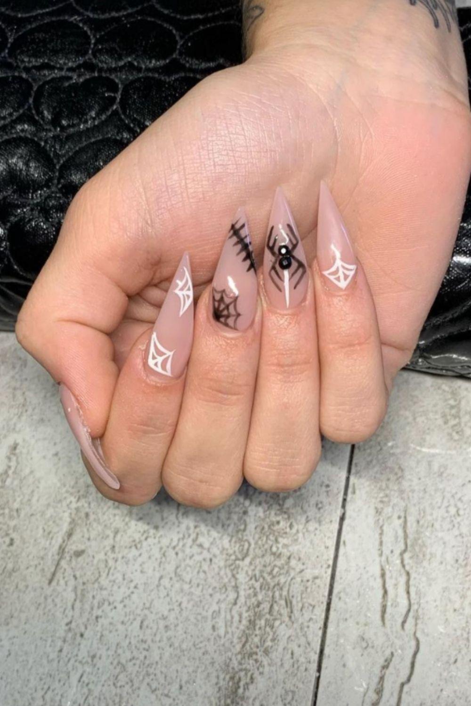 Black and white spider web stiletto nail design