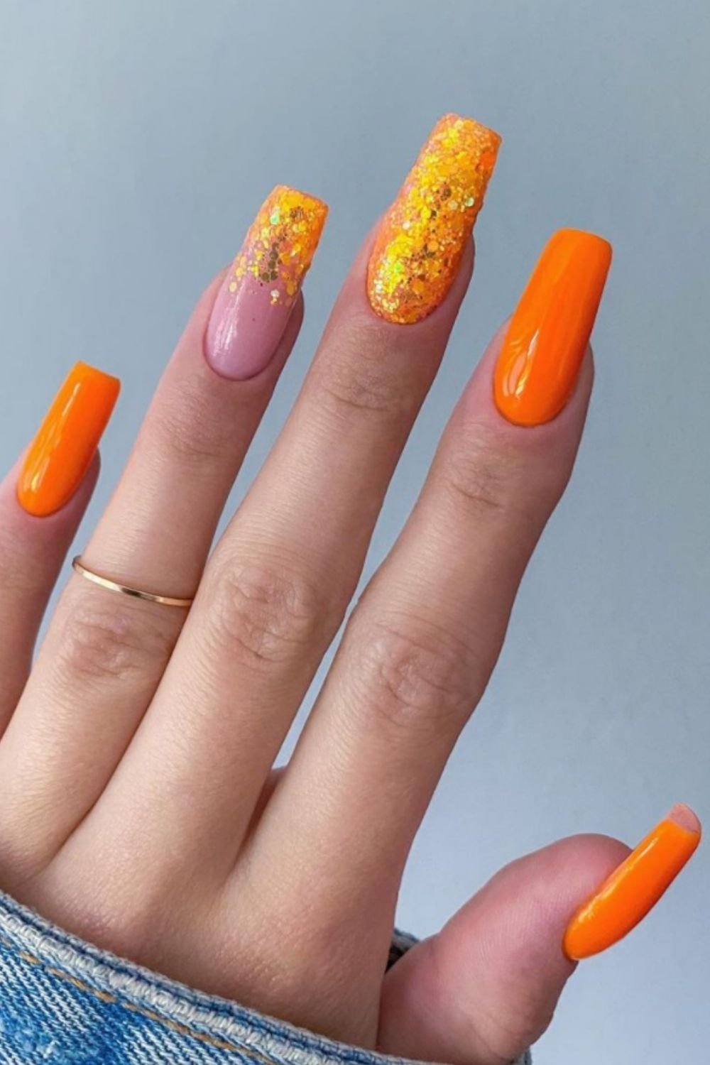 Orange and glitter coffin shaped nail designs