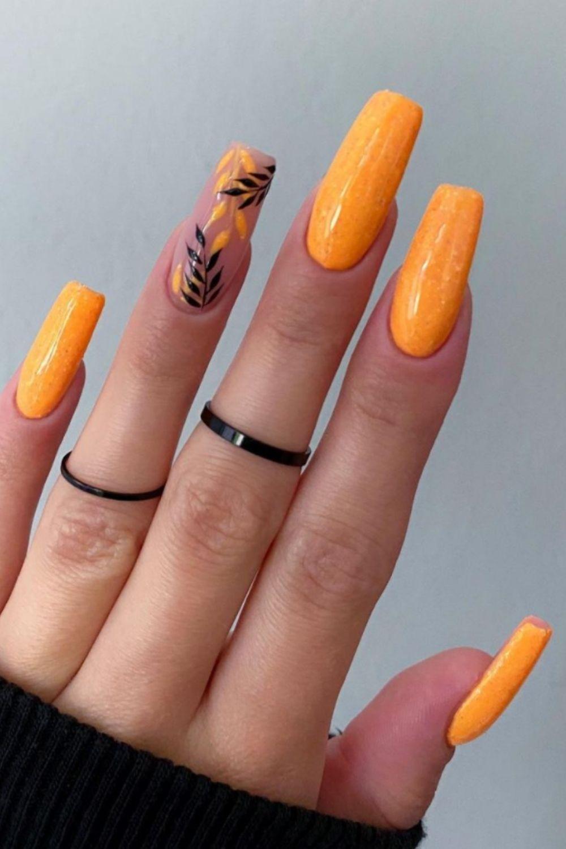 Orange and glitter coffin nails art